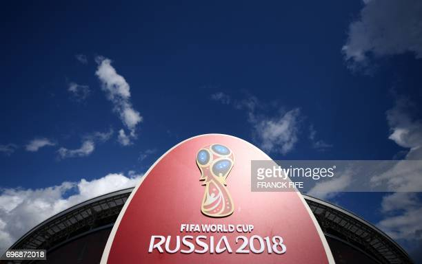 The 2018 World Cup logo is pictured outside the Kazan Arena stadium in Kazan Russia on June 17 2017 ahead of the Russia 2017 Confederation Cup...