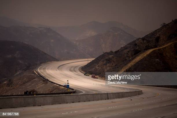 The 210 freeway remains closed to all but emergency traffic as it winds through a scorched landscape at the La Tuna Fire on September 2 2017 near...