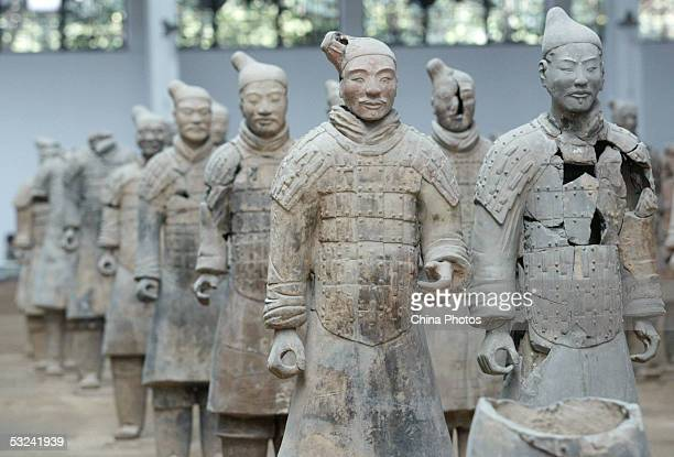 The 2200yearold terracotta army is seen at the Qin Terracotta Warriors and Horses Museum on July 15 2005 in Xian of Shaanxi Province northern China A...