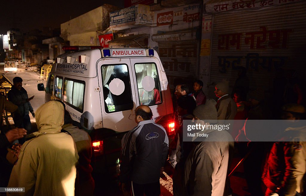 The 23 year old Delhi gang rape victim body being taken in an ambulance after arrival at AFS Palam in New Delhi in wee hours on Sunday.