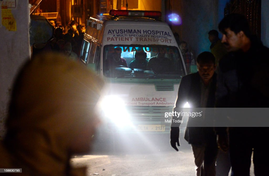 The 23-year old Delhi gang rape victim body being taken in an ambulance after arrival at AFS Palam in New Delhi in wee hours on Sunday.