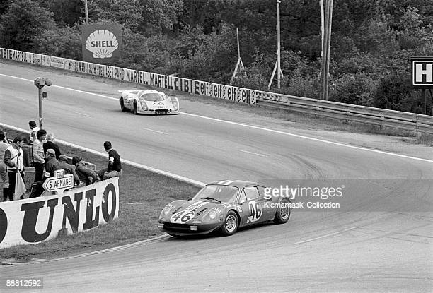 The 24 Hours of Le Mans Le Mans June 1011 1972 Rounding Mulsanne is the Ferrari Dino 246GT driven by Pierre Lafeach and Gilles Doncieux under a NART...