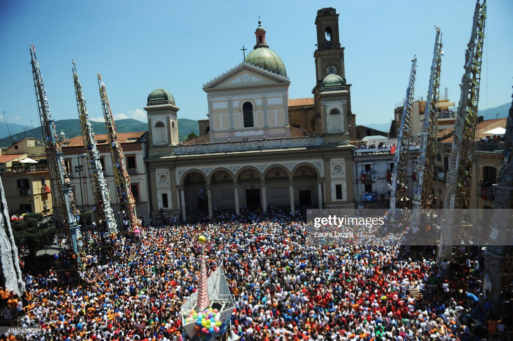 The 25-metre tall 'giglio,' wood and papier-mache statue are displayed in the central square during the annual Festa dei Gigli 'The Lily Festival' on June 22, 2014 in Nola, Italy. The famous festival became a UNESCO World Heritage site. When St. Paolini, (355- 431 AD) the bishop of Nola, returned in a boat after freeing the town's men from captivity at the hands of the Saracens, he was welcomed by the population with lilies ('gigli'). To carry the Gigli, 120 men, called 'paranza,' shoulder one another and walk slowly through the town.