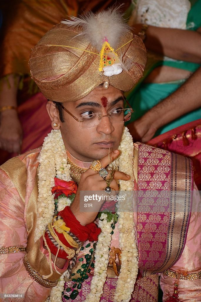 The 27th titular head of the Wodeyar dynasty, 24-year-old Yaduveer Chamraja Krishnadatta Wodeyar watches rituals performed during his and Trishika Kumari of the Dungarpur dynasty of Rajasthan's wedding ceremony at the Amba Vilas Palace in southern Mysore city on June 27, 2016. The royal wedding which happened after four decades, began with invocations to the royal family deity Hindu Goddess Chamundeshwari, as per the Wodeyar's dynastic traditions. / AFP / STR