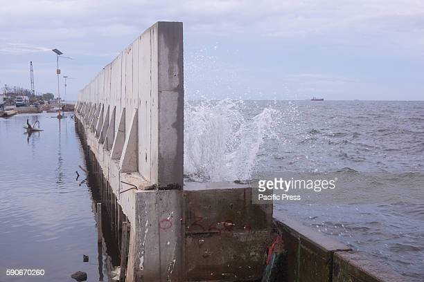 The 2metres new concrete Jakartas giant seawall built on the sinking old wall Jakarta sinking by between 75 and 17 centimetres a year more than 10...
