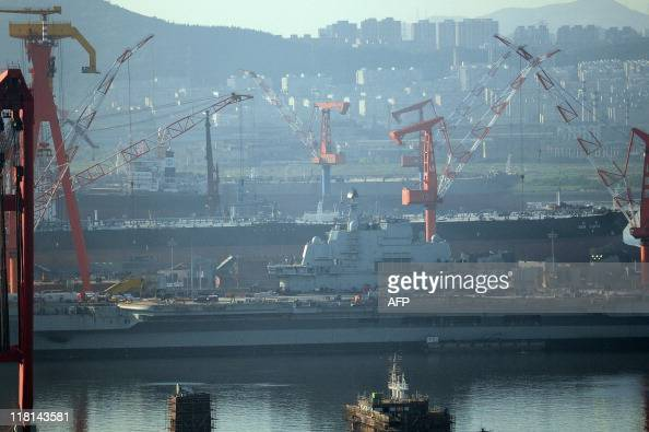 The 300 metre former Soviet carrier originally called the Varyag sits in the port as she is overhauled in the northeast port of Dalian northwest...