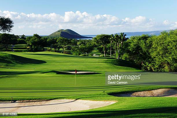 The 353 yard par 4 9th hole on the Wailea Golf Club Gold Course in Wailea on the island of Maui Hawaii USA