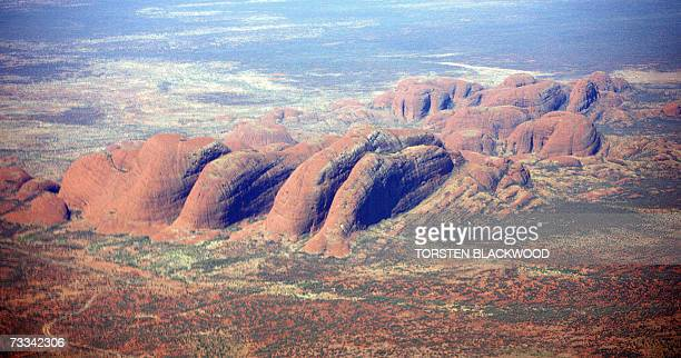 The 36 granite and basalt conglomerate domes of Kata Tjuta also known as the Olgas rise up to 546 metres above the surrounding desert in central...