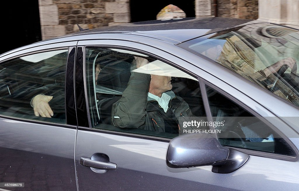 The 36 year-old woman arrested on November 29, 2013 in Saint-Mande, outside Paris, who confirmed having killed her daughter found dead on November 20, 2013 in Berck-sur-Mer arrives hidden by a blanket in a police car on November 30, 2013 at the Courthouse in Boulogne-sur-Mer, Northern France to be presented to the judge.