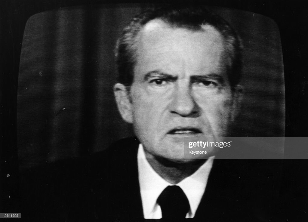 The 37th President of the United States, <a gi-track='captionPersonalityLinkClicked' href=/galleries/search?phrase=Richard+Nixon&family=editorial&specificpeople=92456 ng-click='$event.stopPropagation()'>Richard Nixon</a>, on a television screen.