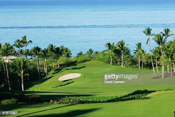 The 380 yard par 4 1st hole on the Wailea Golf Club Emerald Course in Wailea on the island of Maui Hawaii USA