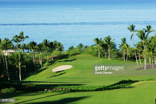 The 380 yard par 4 1st hole on the Wailea Golf Club Emerald Course in Wailea on the island of Maui Hawaii USA