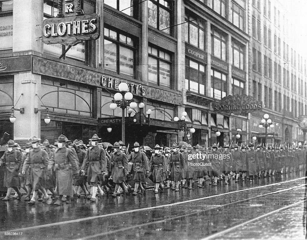 The 39th Regiment on its way to France marched through the streets of Seattle Washington every one provided with a mask made by the Seattle Chapter...