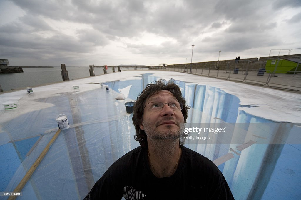 The 3D street painting 'Crevasse' by artist Edgar Mueller is seen in this undated picture during the 'Festival of culture' from August 21-24, 2008 in Dun Laoghaire, Irland. Edgar Mueller put a part of the eastern Pier into the ice age. This project has been supported by the Goethe Institution Germany.