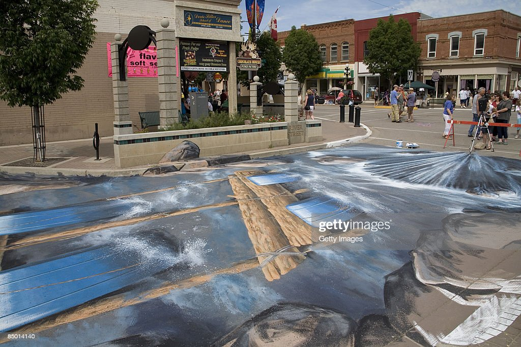 The 3D street painting 'Turning Riverstreet into a river' (The waterfall) by artist Edgar Mueller is seen in this undated picture. 'Turning Riverstreet into a river' is the largest 3d-street-painting ever done. About 280 m² are covered with paint. Edgar Mueller realized it together with local artists at the Moose Jaw Prairie Arts Festival in 2007.