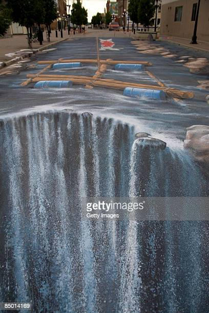 The 3D street painting 'Turning Riverstreet into a river' by artist Edgar Mueller is seen in this undated picture 'Turning Riverstreet into a river'...