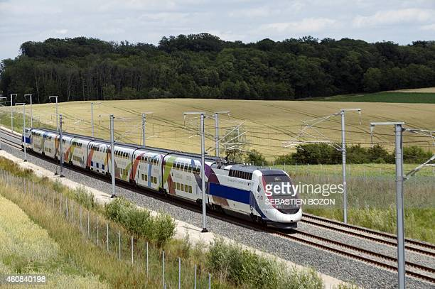 The 3rd generation duplex TGV High speed train runs during a test between Dijon and Besancon on June 20 2011 in AuxonDessus eastern France on the new...