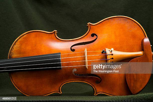 The 400th instrument that Robert McCluskie created by hand a violin made from red maple and red spruce is photographed at his home March 2015 in...