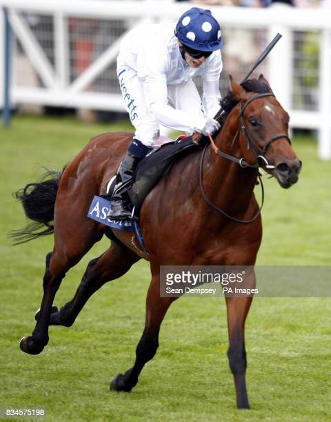 The 420 Coventry stakes the winner in the blue spotted hat ART CONNOISSEUR ridden by Jockey Jamie Spencer at Ascot Racecourse Berkshire