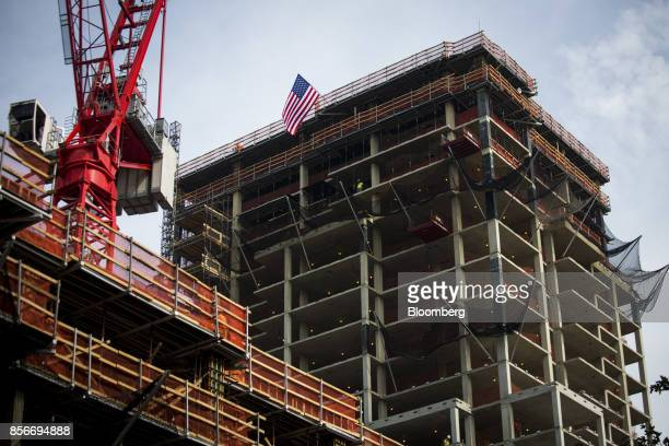 The 420 Kent Avenue left and 416 Kent Avenue apartment developments stand under construction in the Williamsburg neighborhood of the Brooklyn borough...