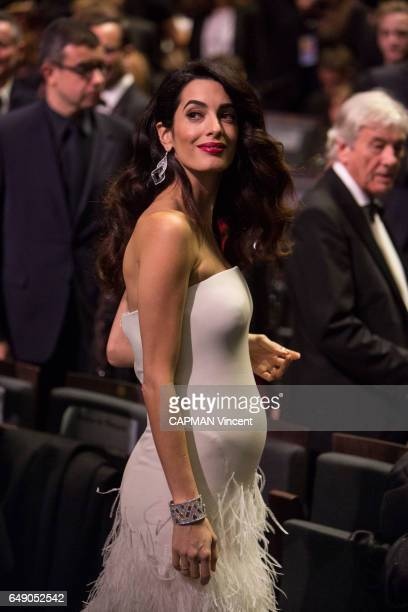 The 42nd Cesars Award ceremony in Paris at the Salle Pleyel on February 24 2017 Amal Clooney pregnant wearing an Atelier Versace dress