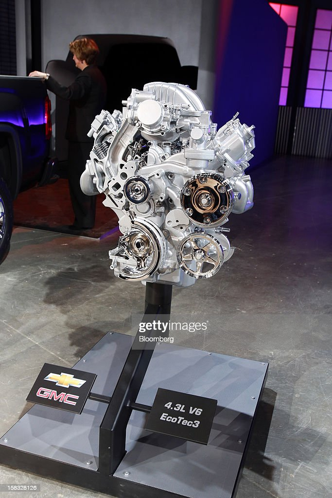 The 4.3L V6 EcoTec3 engine of the General Motors Co. (GM) 2014 GMC Sierra pickup truck is displayed during the vehicle's unveiling at an event in Pontiac, Michigan, U.S., on Thursday, Dec. 13, 2012. Even with the recent cloud of high existing truck inventories, the new Chevrolet Silverado and GMC Sierra pickups hold the promise of giving GM's investors, the U.S. government included, a long awaited boost. Photographer: Fabrizio Costantini/Bloomberg via Getty Images