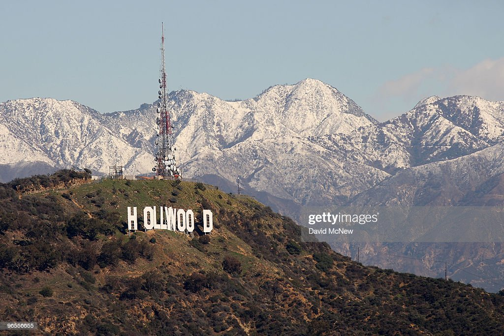 The 450footlong Hollywood sign and the undeveloped land that surrounds it are seen against the snowcovered San Gabriel Mountains as a storm breaks up...