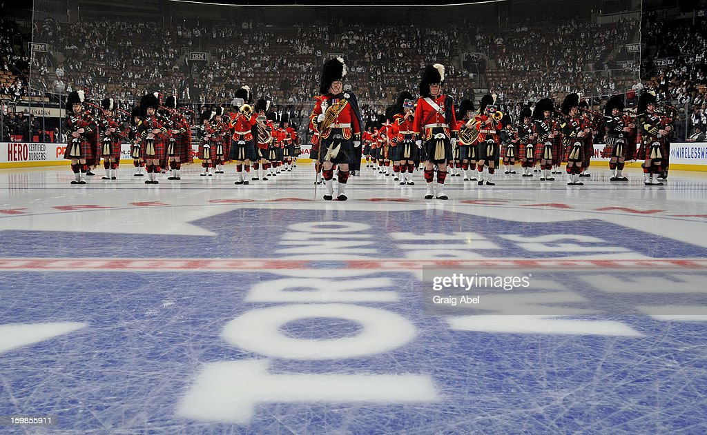 The 48th Highlanders take part in an on ice ceremony prior to NHL game action between the Toronto Maple Leafs and Buffalo Sabres January 21, 2013 at the Air Canada Centre in Toronto, Ontario, Canada.