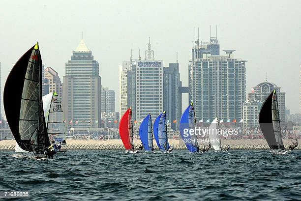 The 49er class 18foot skiff race towards the finish line with the backdrop of the city on the first day of competition in China's largestever regatta...