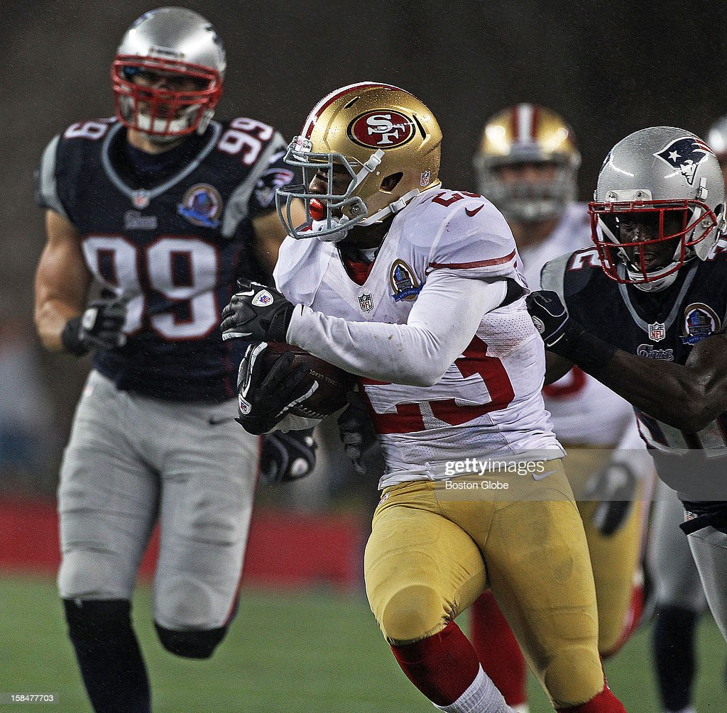 The 49ers' LaMichael James eludes Patriots defenders on his way to a 60-yard plus kickoff return that set San Francisco up for a touchdown that broke the 31-31 tie as the New England Patriots hosted the San Francisco 49ers in a Sunday night NFL game at Gillette Stadium.