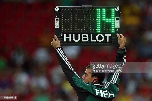 The 4th Official holds up the substitutes board during the FIFA Confederations Cup Brazil 2013 Group A match between Italy and Japan at Arena...