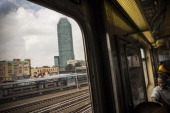 The '5 Pointz' building is seen from a passing subway car on August 9 2013 in the Long Island City neighborhood of the Queens borough of New York...