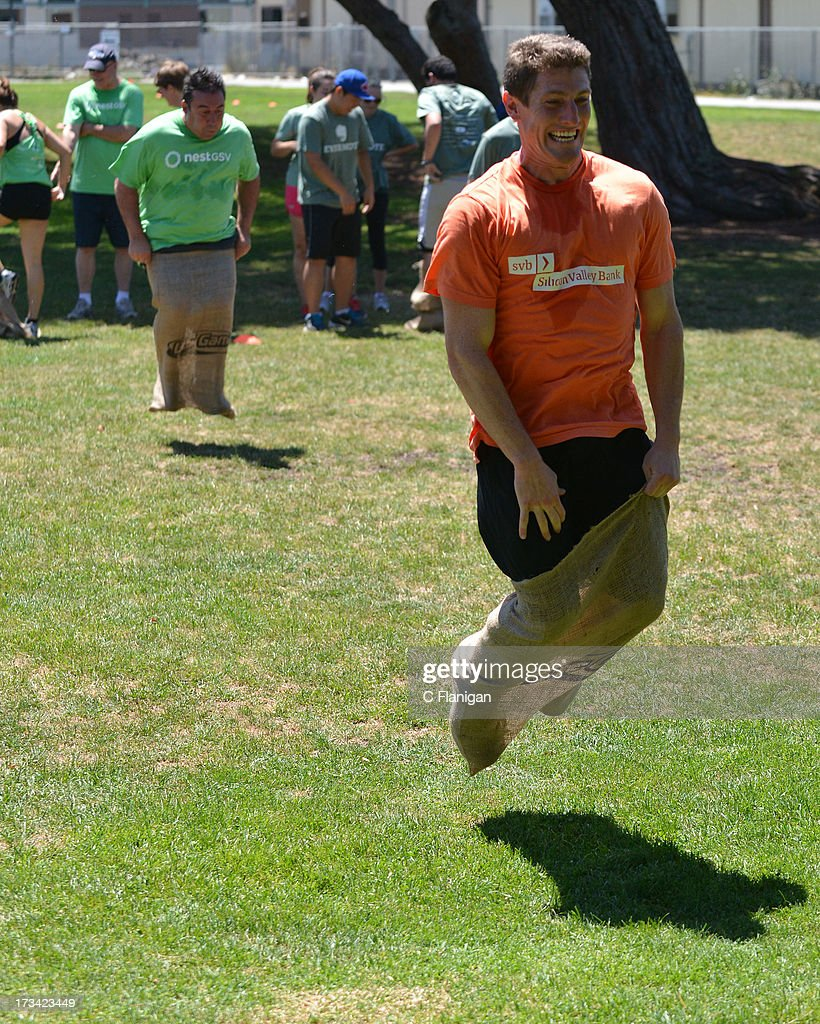 The 500 nestGSV and Silicon Valley Banks Teams complete in the Burlap Sack Race during the Founder Institute's Silicon Valley Sports League event on July 13, 2013 in Palo Alto, California.