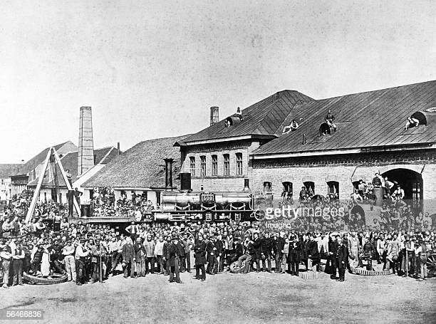 The 500th locomotive leaves the factory Maffei in Hirschau near Munich 1864 Workers are posing with the engine Photography by J Albert [Die 500...