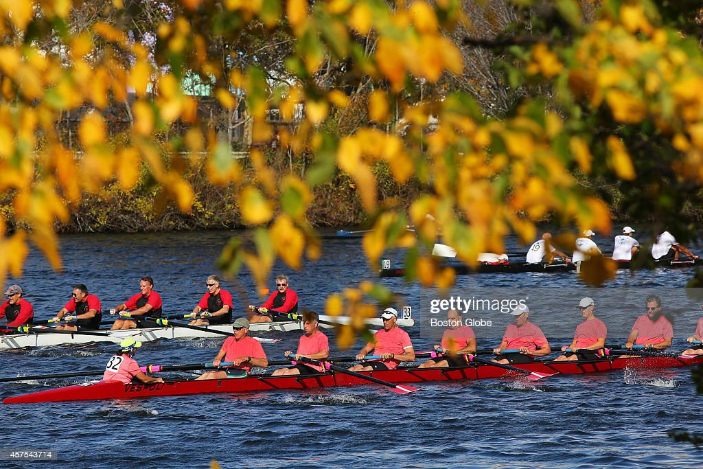 The 50th anniversary of the Head of the Charles Regatta took place along the Charles River Foliage along the banks of the Charles frame rowers from...