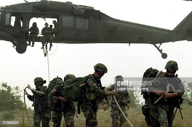 The 525th Military Intelligence Brigade conducts aerial recovery training July 19 2006 at Fort Bragg in North Carolina Two types of training are...