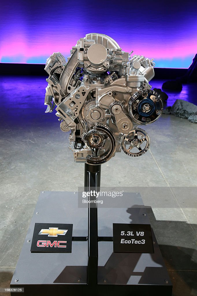The 5.3L V8 EcoTec3 engine of the General Motors Co. (GM) 2014 GMC Sierra pickup truck is displayed during the vehicle's unveiling at an event in Pontiac, Michigan, U.S., on Thursday, Dec. 13, 2012. Even with the recent cloud of high existing truck inventories, the new Chevrolet Silverado and GMC Sierra pickups hold the promise of giving GM's investors, the U.S. government included, a long awaited boost. Photographer: Fabrizio Costantini/Bloomberg via Getty Images