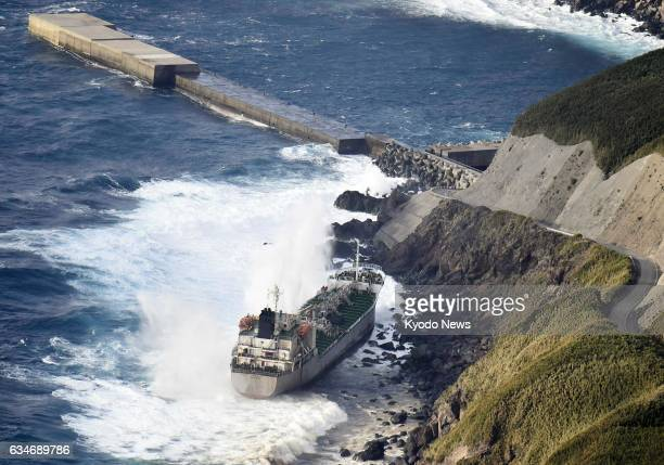 The 5404ton Sagan a Panamanianregistered tanker is seen after going aground on Suwanose Island in Kagoshima Prefecture southwestern Japan in this...