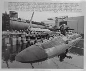 The 560 foot Ohio America's first Trident submarine floats in her graving dock here at the General Dynamics shipyard in Groton Connecticut prior to...