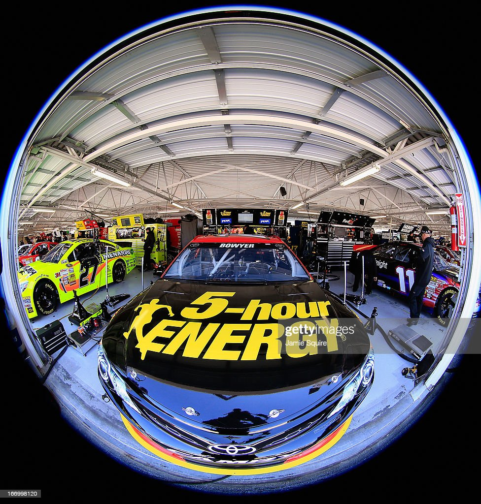 The #15 5-hour ENERGY Toyota of Clint Bowyer sits in the garage area during practice for the NASCAR Sprint Cup Series STP 400 at Kansas Speedway on April 19, 2013 in Kansas City, Kansas.