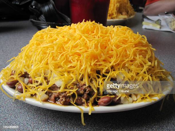 The 5Way Chili consists of meats beans onions and cheddar cheese on top of spaghetti at Camp Washington Chili in Cincinnati