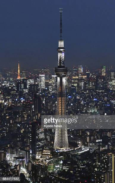 The 634metertall Tokyo Skytree in the capital's Sumida district is specially illuminated in orange on May 18 ahead of the fifth anniversary of the...
