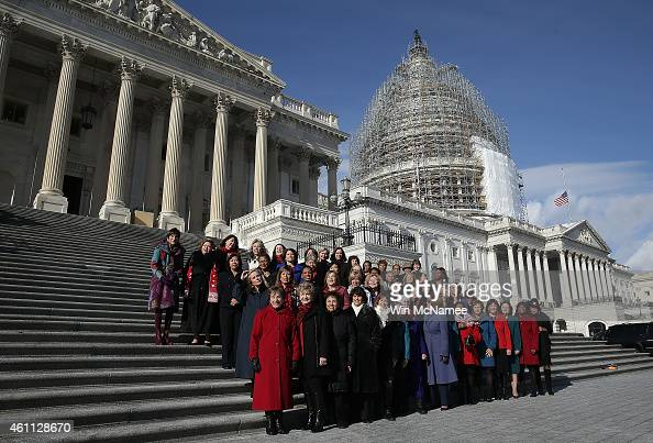 The 65 House Democratic women elected to the 114th Congress gather on the steps of the US Capitol for a group photo January 7 2015 in Washington DC...