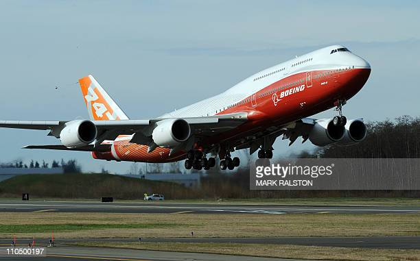 The 7478 Intercontinental Boeing's largestever passenger airplane takes off for the first time from Paine Field in Everett Washington state on March...