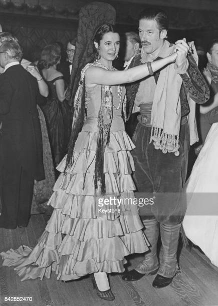 The 7th Earl of Harewood and the Countess of Harewood in Spanish dress for the Opera Ball at the Dorchester Hotel in London 13th February 1958 The...