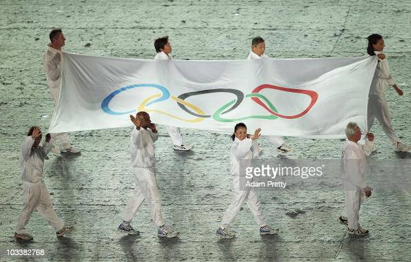 The 8 Olympians carry the Olympic Flag to the Opening Ceremony of the 2010 Youth Olympics at The Float@Marina Bay on August 14 2010 in Singapore