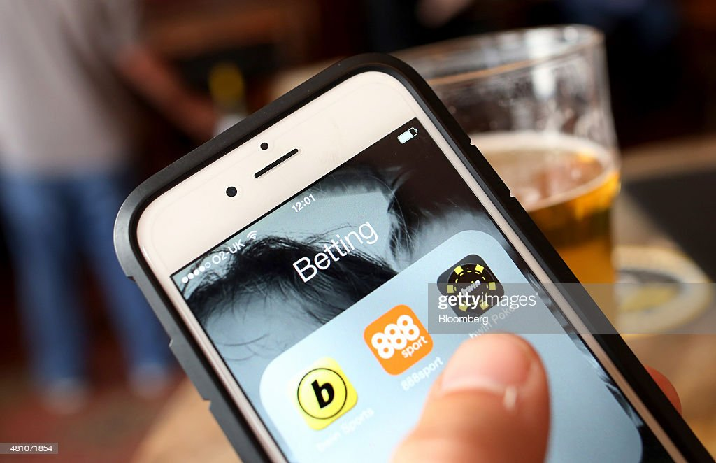 The 888 Holdings Plc sports betting app, centre, the Bwin.party Digital Entertainment Plc sports betting app, left, and the Bwin.party Digital Entertainment Plc online poker app sit on a smartphone device in this arranged photograph taken in London, U.K., on Friday, July, 17, 2015. 888 Holdings Plc agreed to buy Bwin.party Digital Entertainment Plc for 898.3 million-pounds ($1.4 billion) in cash and shares, winning over the online gaming company that's been at the center of a takeover battle. Photographer: Chris Ratcliffe/Bloomberg via Getty Images