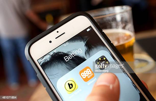 The 888 Holdings Plc sports betting app centre the Bwinparty Digital Entertainment Plc sports betting app left and the Bwinparty Digital...