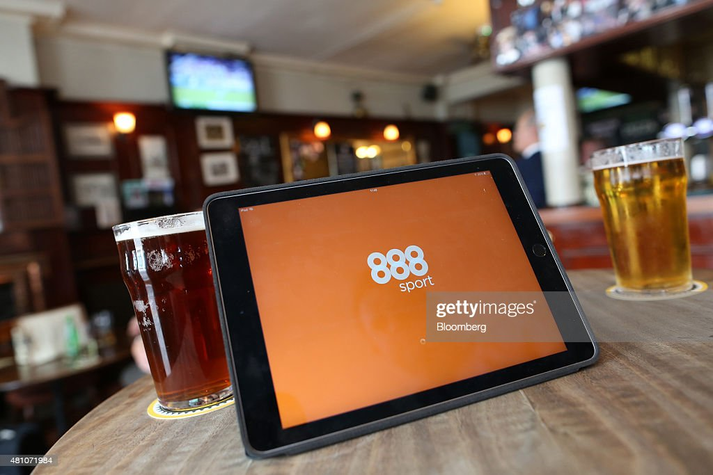 The 888 Holdings Plc sports betting app homepage sits on a tablet device in this arranged photograph taken in London, U.K., on Friday, July, 17, 2015. 888 Holdings Plc agreed to buy Bwin.party Digital Entertainment Plc for 898.3 million-pounds ($1.4 billion) in cash and shares, winning over the online gaming company that's been at the center of a takeover battle. Photographer: Chris Ratcliffe/Bloomberg via Getty Images