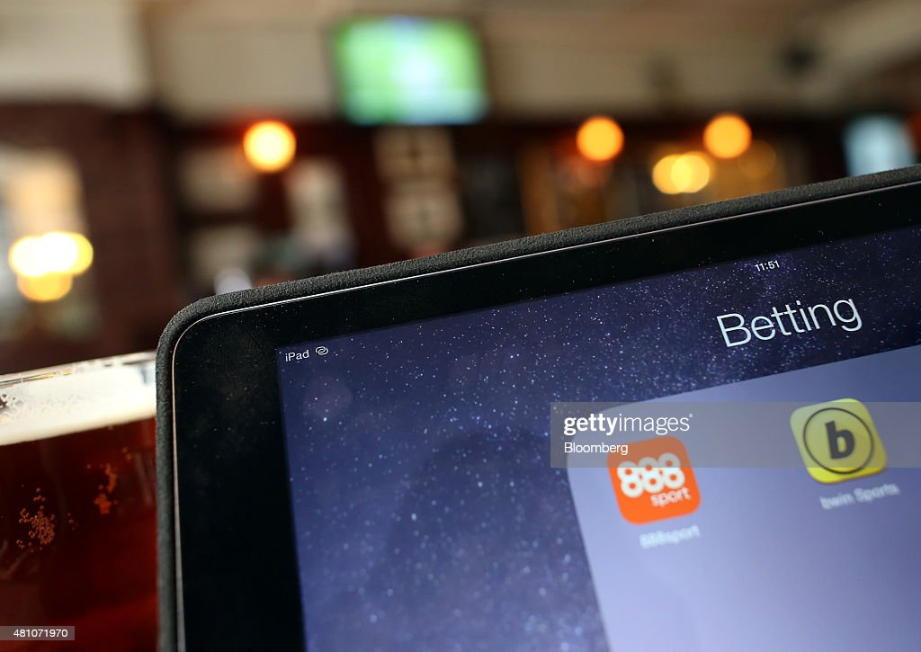The 888 Holdings Plc sports betting app, left and the Bwin.party Digital Entertainment Plc sports betting app sit on a tablet device in this arranged photograph taken in London, U.K., on Friday, July, 17, 2015. 888 Holdings Plc agreed to buy Bwin.party Digital Entertainment Plc for 898.3 million-pounds ($1.4 billion) in cash and shares, winning over the online gaming company that's been at the center of a takeover battle. Photographer: Chris Ratcliffe/Bloomberg via Getty Images
